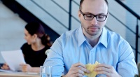 Sad business man eating cheese alone