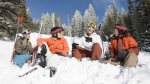 Skiier-Friends-Hanging-Out-In-Snow-Mountain