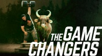 The-Game-Changers-Movie-Strong-Man-Bull-Eating-Grass.