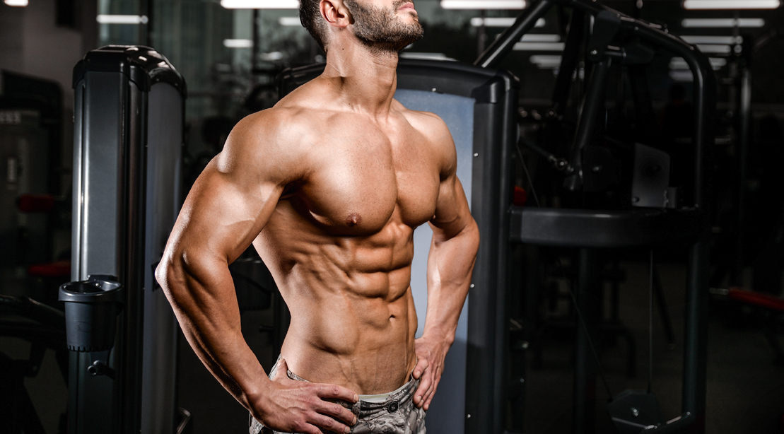 Fit man with a muscular physique showing off his shredded abs that reveals the lower abs