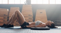 woman-laying-floor-gym-1109