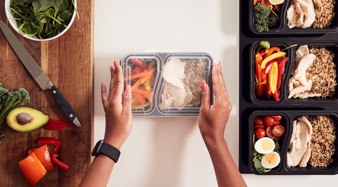 Woman Meal Prepping Healthy Food in the Kitchen