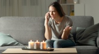 Annoyed-Girlfriend-Female-On-Couch-Talking-On-Cell-Phone