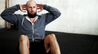 Bald-Man-With-Beard-Performing-Situp