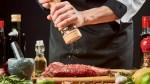 Chef-Seasoning-Steak-Meat-With-Pepper-Grinder