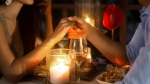 Couple-Holding-Hands-Over-Romantic-Dinner