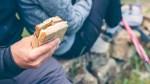 Couple-In-Workout-Gear-Male-Holding-Simple-Sandwich