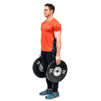 Don-Salidino-Performing-Plate-Shrug-Exercise-Step-One