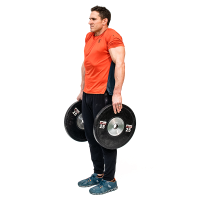 Don-Salidino-Performing-Plate-Shrug-Exercise-Step-Two