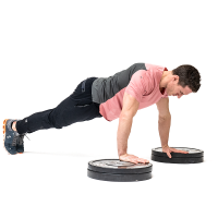 Don-Salidino-Performing-Plate-Pushup-Exercise-Step-Two