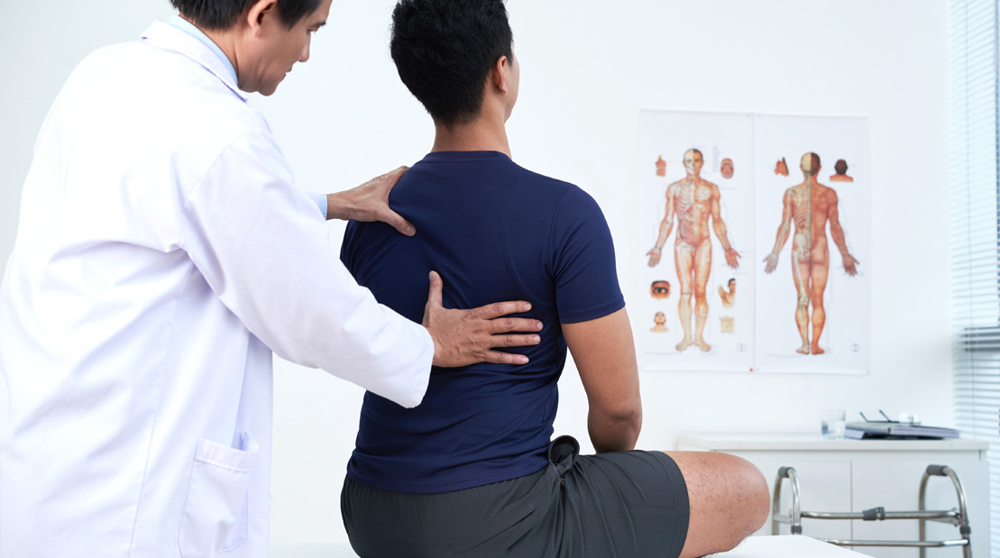 Doctor-Examining-Patient-Back-And-Posture