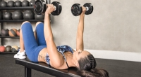 Female-Fitness-Person-Performing-Flat-Back-Dumbbell-Bench-Press-Excercise