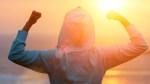 Female-In-Hoodie-Flexing-Muscle-In-Sunset-Sunrise
