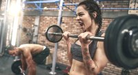 Female-Screaming-In-Gym-Peforming-Barbell-Curl