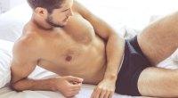 Male-Model-Laying-In-Bed-In-Underwear