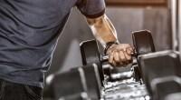 Man-Lifting-Heavy-Dumbbell-Rack