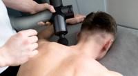 Masseuse-Using-Massage-Gun-On-Shoulder