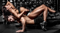 Muscular-Man-Doing-Pushup-With-Sexy-Female-On-His-Back