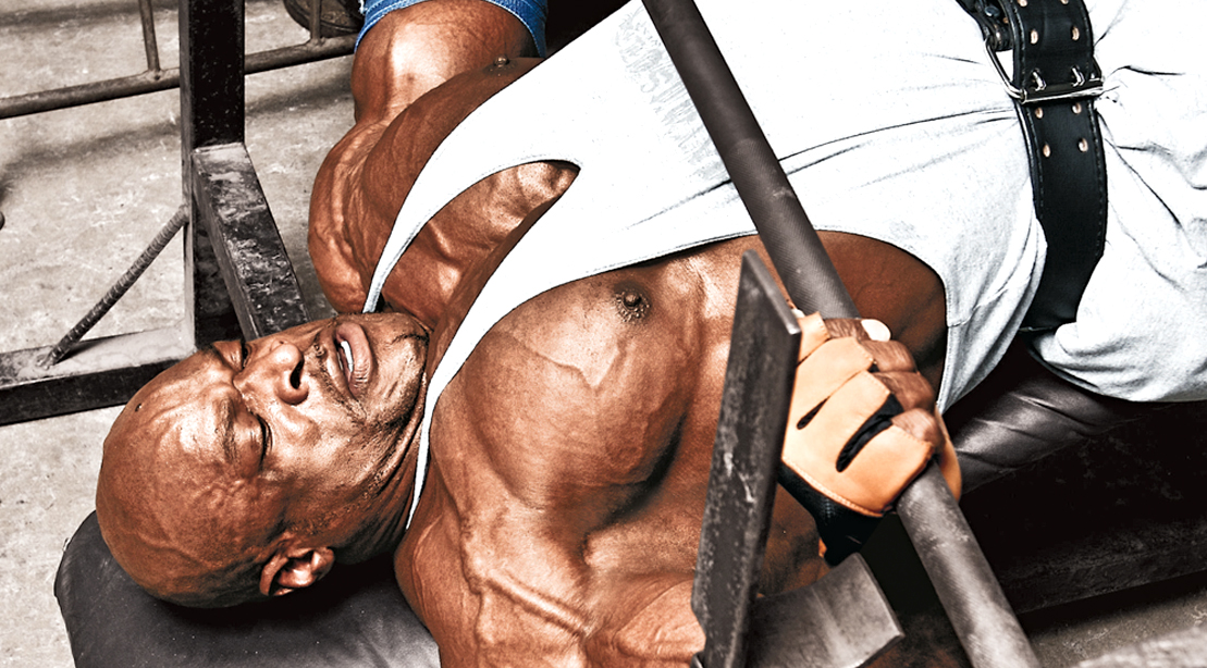 Bodybuilder Ronnie Coleman working out his chest with with a decline barbell press