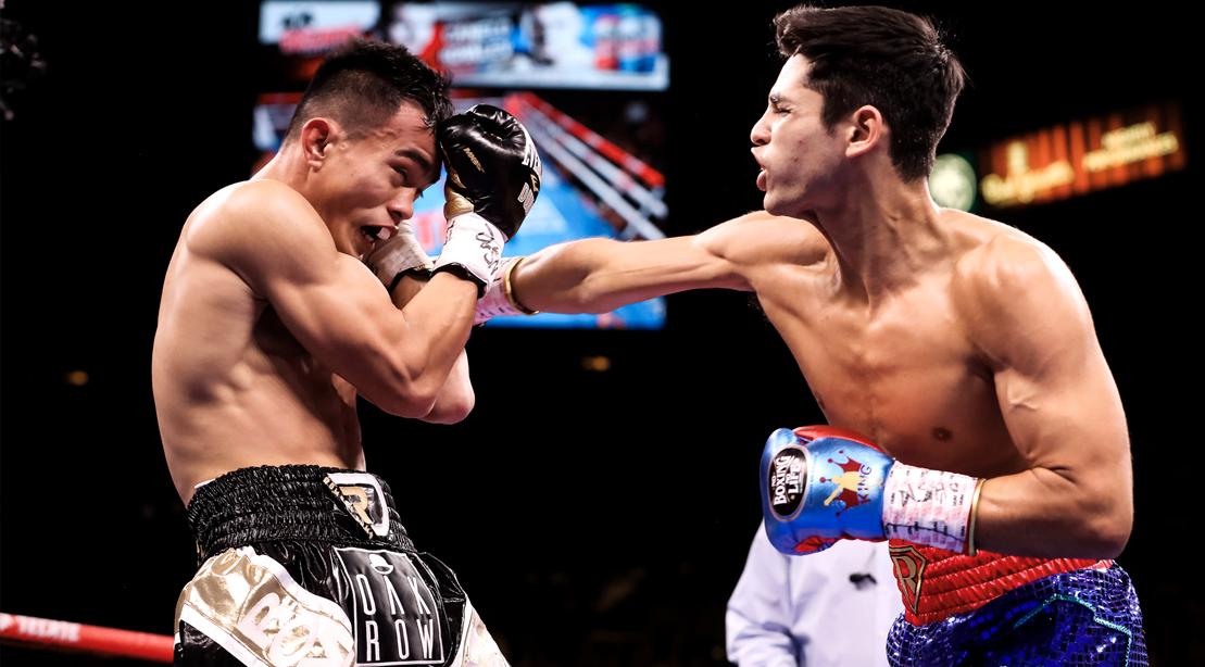Ryan-Garcia-Punching-Romero-Duno-Boxing-Ring-Fight-Gloves