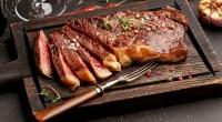 Steak-Dinner-On-Wooden-Cutting-Board