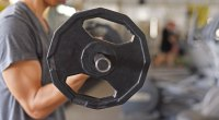 Beginners - bodybuilding - doing - barbell - muscle - curl - exercise