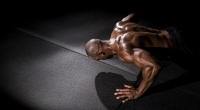 Black-Man-Doing-Pushup-In-Dark-Room