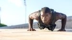 Black-Man-Doing-Pushups-Outdoors-With-A-Weighted-Vest