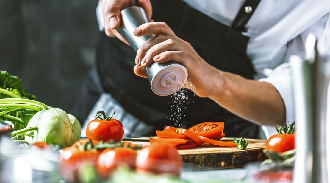 Chef-Seasoning-Tomato-With-Salt