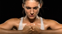 Female Fighter With Fists Together Meditating