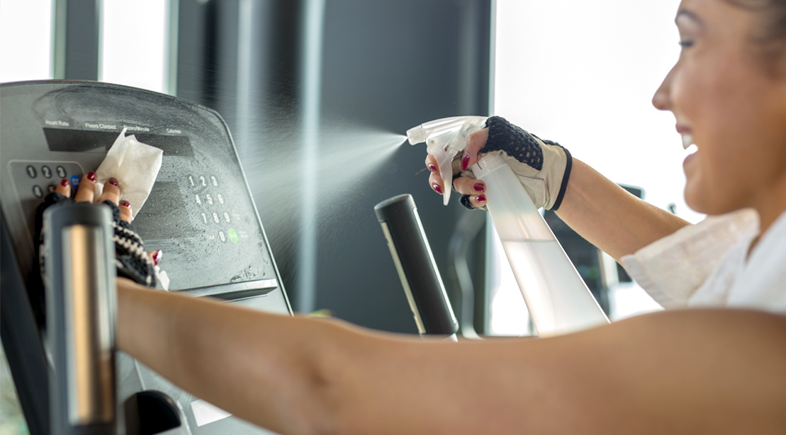 Female-Spraying-Treadmill-Console-with-Disinfectant