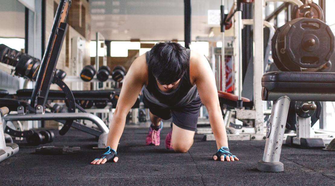 Fitness-Beginner-Crawling-On-Gym-Floor