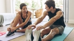 Fitness-Couple-Warming-Up-For-Home-Workout