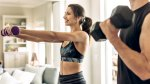 Fitness-Couple-Working-Out-At-Home-With-Dumbbells
