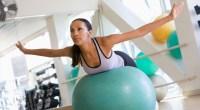 Fitness-Girl-On-Swiss-Ball-Doing-YTi-Exercise