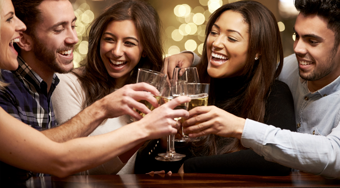 Group-Of-Happy-People-Drinking-And-Cheering-Alcohlic-Beverages