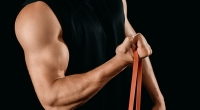 Male Perform Bicep Curl Exercise With Band