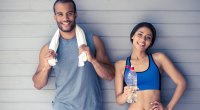 Male and female friends partners wearing fitness equipment