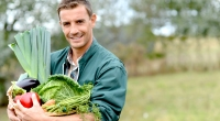 Man-Holding-A-Basket-Full-Of-Vegetables
