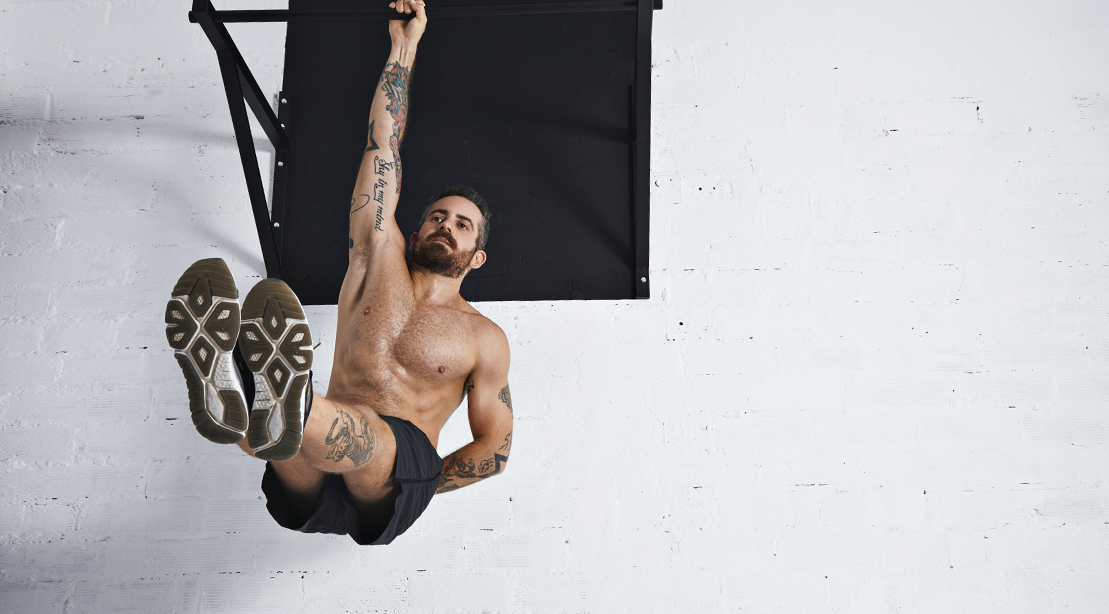 Man-Performing-Single-Handed-Leg-Raise-Exercise