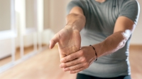 Man-Stretching-Forearm-Hand-And-Fingers