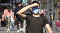Man-Wearing-Coronavirus-Face-Mask-Touching-His-Forehead