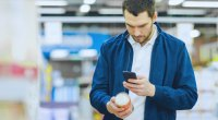 Man-With-Beard-Taking-Picture-Of-Can-Product-With-SmartPhone
