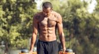 Muscular-Black-Man-Performing-Outdoor-Dip-While-Shirtless