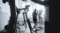 Overweight - man - walking around - empty - gym