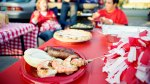 Shrimp-Skewers-and-Sausage-On-Picnic-Table-At-Tailgate-Party