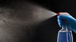 Spraying-Disinfectant-Cleaner-In-The-Air