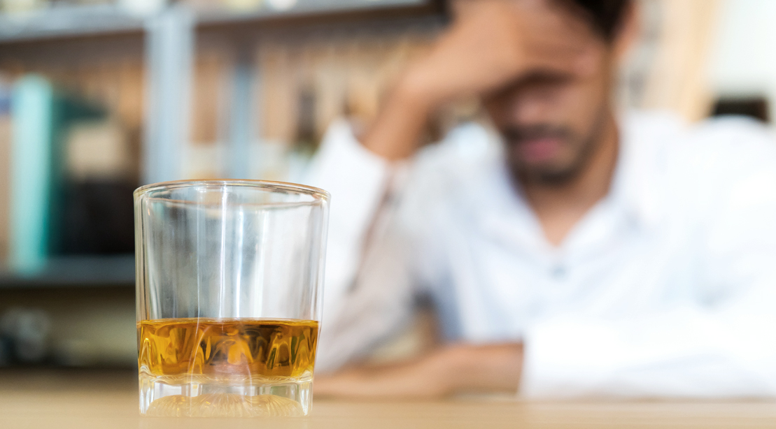 Stressed-Man-At-A-Bar-Drinking-Whiskey