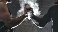 Two-Males-Grasping-Smokey-Hands