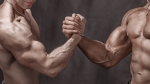 Two-Muscular-Males-Arm-Wrestling-Holding-Hands